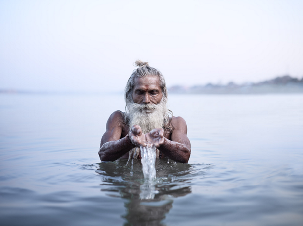 "Vijay Nund performing morning rituals in the Ganges River, the most sacred river in Hinduism. Varanasi, India (""Holy Men"" Personal Series)"
