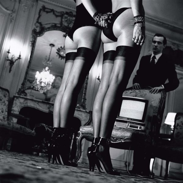 05-Two-pairs-of-legs-in-black-stockings-by-Helmut-Newton-600x600